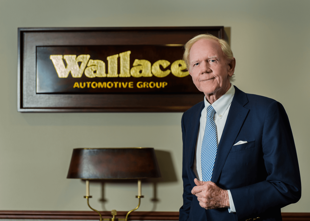 Bill Wallace gives thumbs up inside his office at Wallace Automotive Group in Stuart, FL