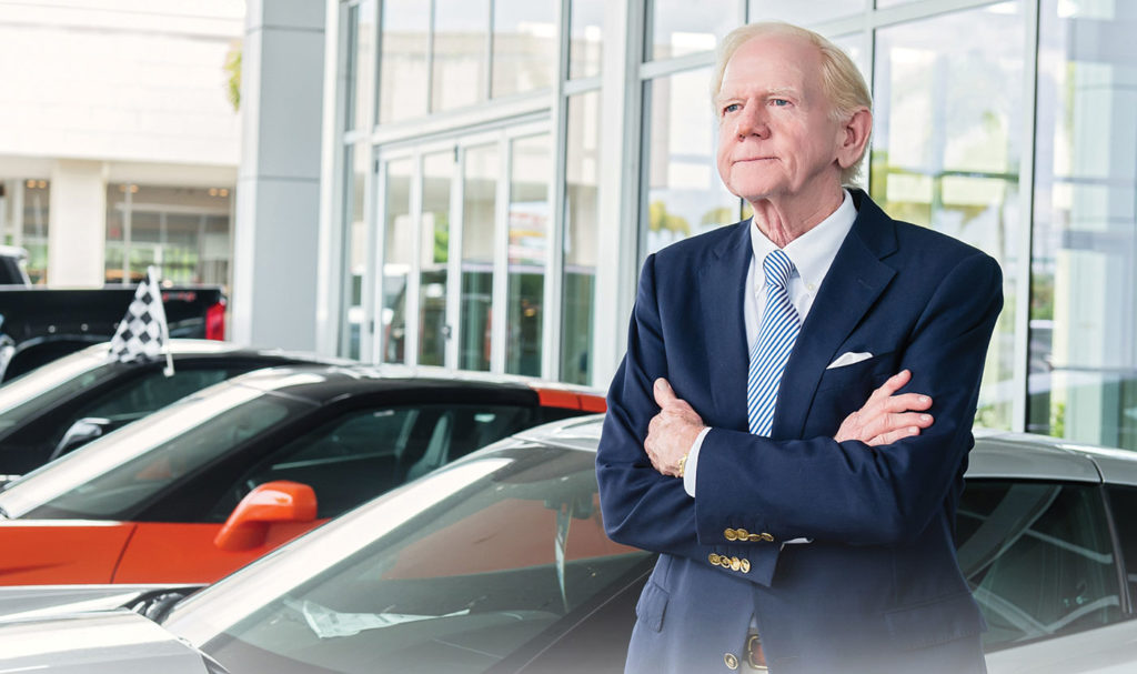 Bill Wallace stands out front of his Wallace Chevrolet Dealership near Stuart, Florida